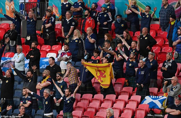 Scotland supporters are pictured watching the highly-anticipated match at Wembley Stadium in north London in the rain