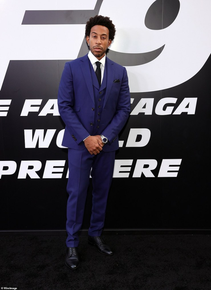 Dapper:Ludacris looked dapper in a royal blue suit that coordinate with his wife's stunning floor-length gown that provided a small glimpse at her growing bump