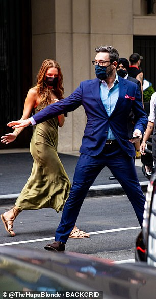 Saving grace: And Anna was seen cautiously following his lead as she donned an olive slip dress