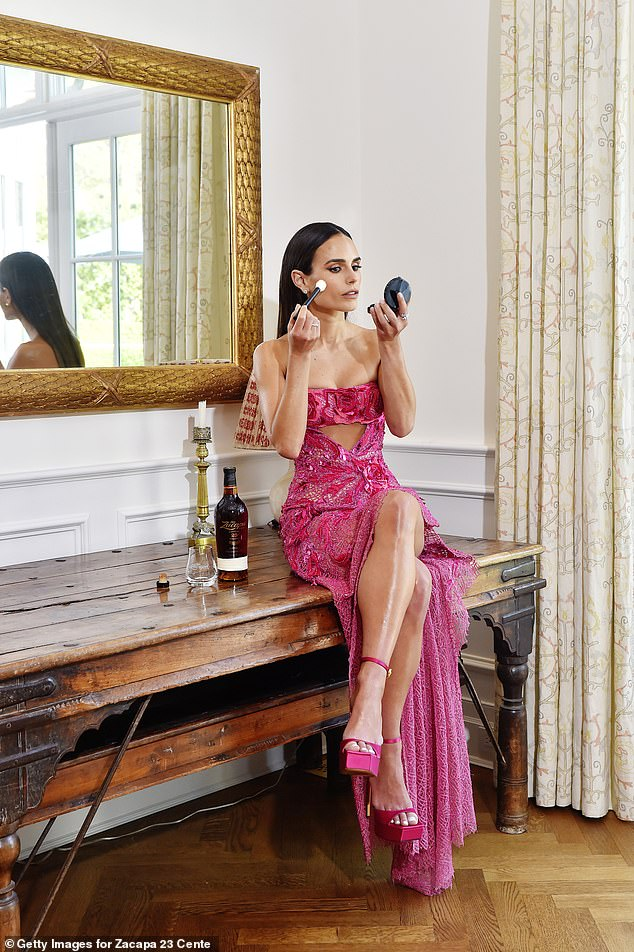 Pretty in pink: Jordana's lacy hot pink dress had an intricate spiderweb-like design and a high slit that showcased her toned and tanned legs