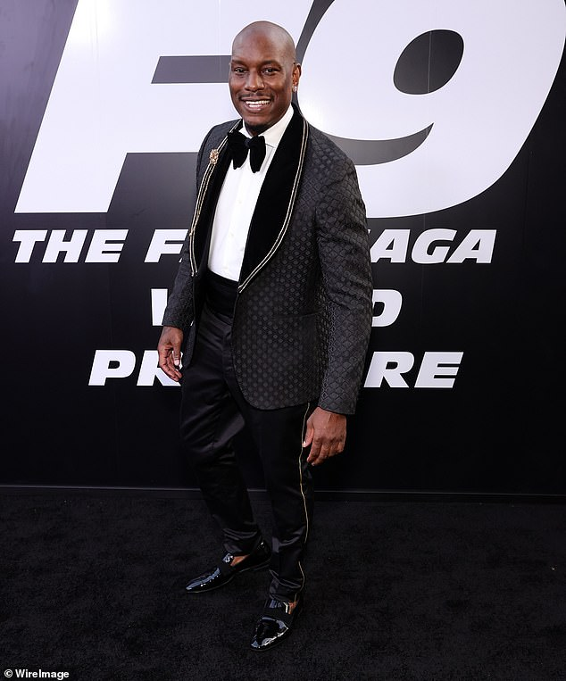Classic style:Tyrese also looked dapper in black thanks to his waffle-textured tuxedo jacket with wide lapels