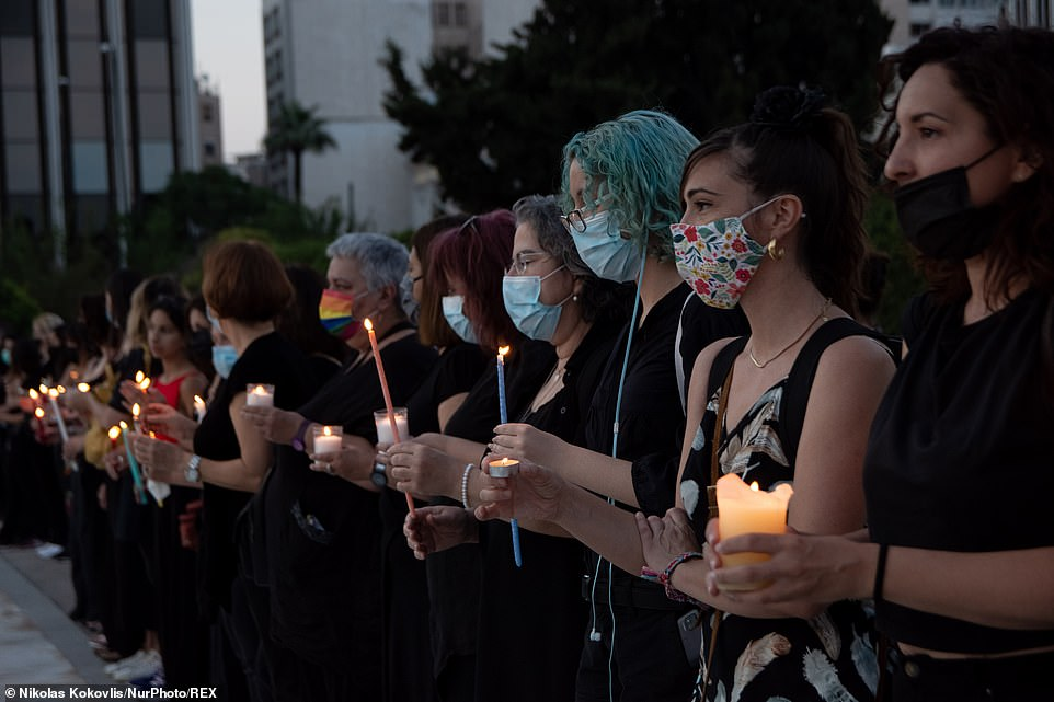 Mourners who gathered for a vigil wore black clothes and held candles in honour of Caroline Crouch in Syntagma Square, in front of the Greek Parliament in Athens on Saturday night