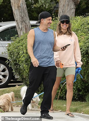 In conversation: Kelly wore a pale peach sweatshirt for the outing, as well as cropped light green biker shorts