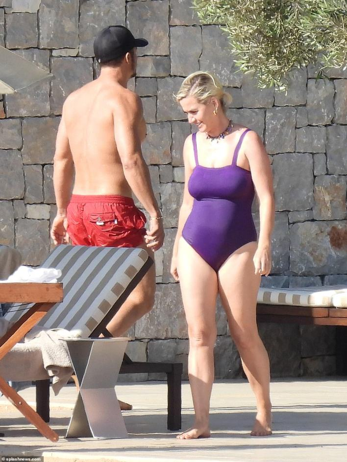 So happy: Katy flashed a broad smile as she shared a moment with her husband-to-be