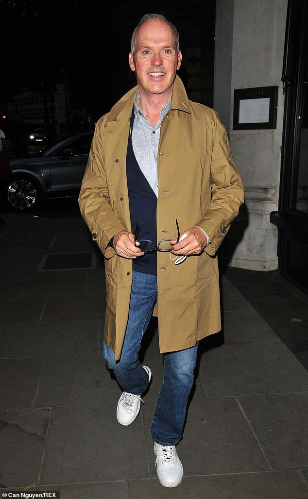 Private meal: The leading actor, 69, wore denim jeans and a camel coat as he arrived at The Oscar on Southampton Row in Camden