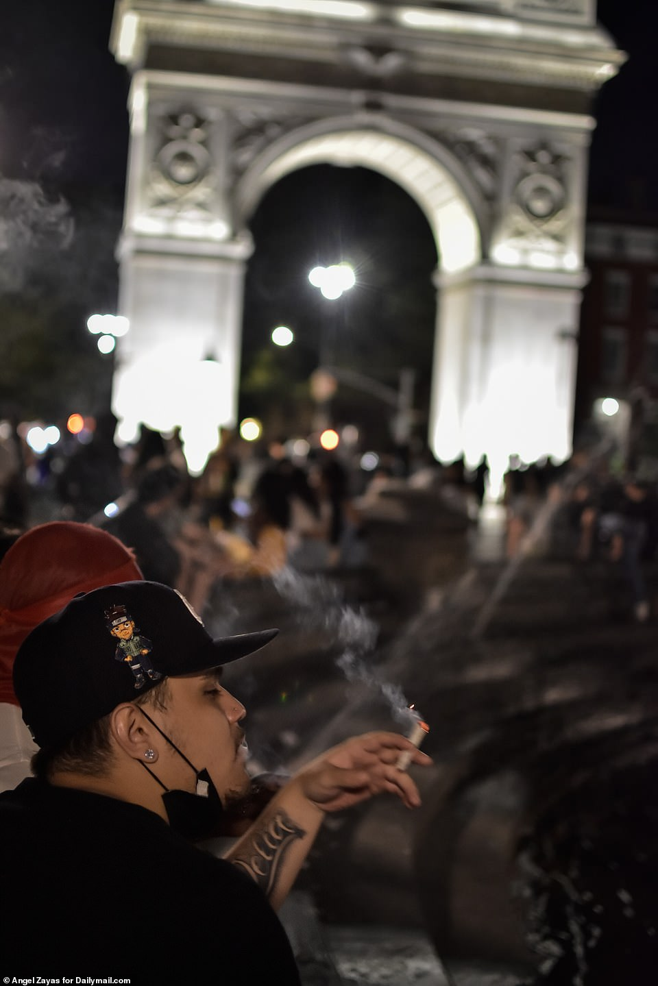 People gather inside Washington Square Park Friday night for another night of late-night revelry and drinking