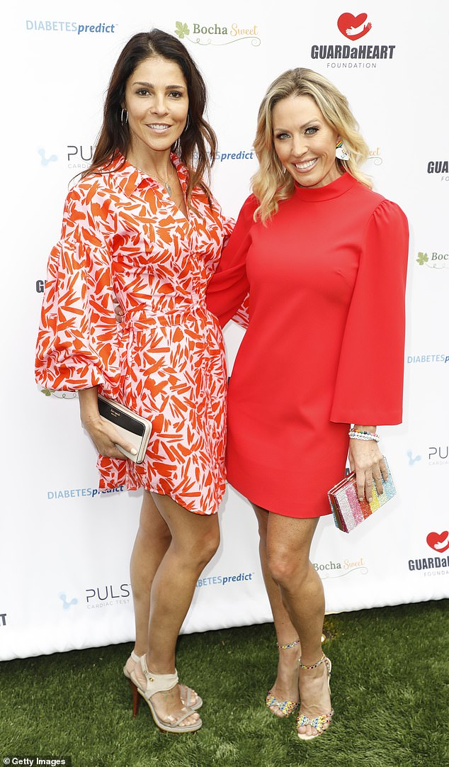 In sync: Braunwyn Windham-Burke and girlfriend Fernanda Rocha made a color-coordinated fashion statement when they attended a charity event in Newport Beach on Saturday