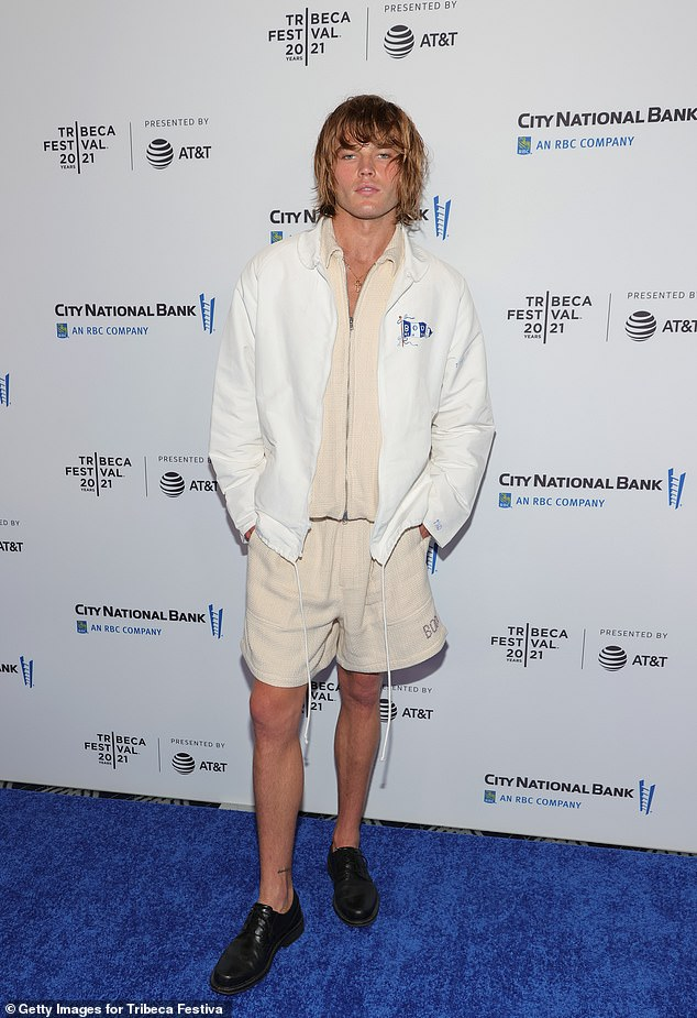 Summery: Australian model Jordan Barrett wore a cream tracksuit set for the premiere, complete with shorts and a white overlay