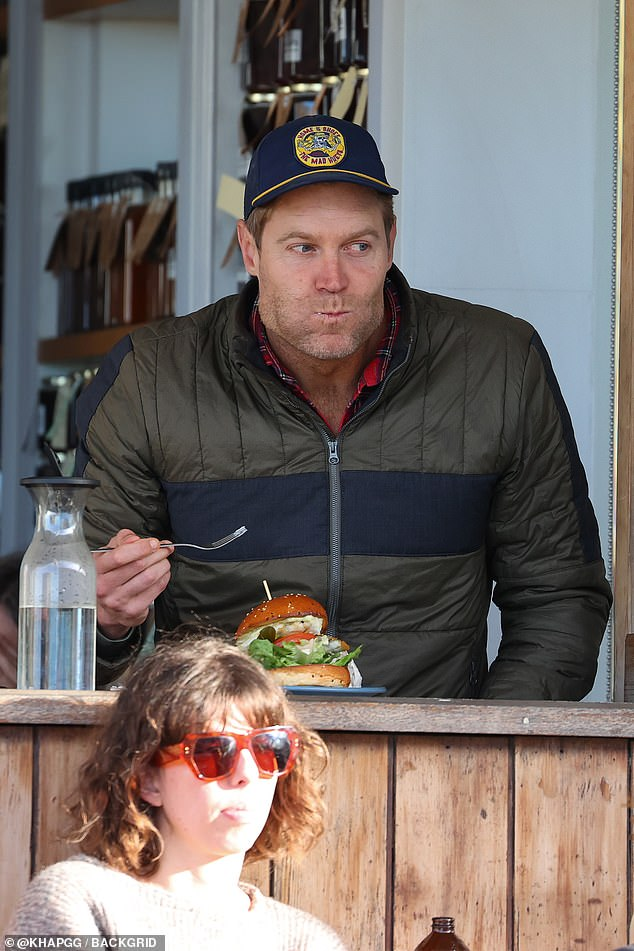 Lunch time!  The vet was spotted enjoying a breakfast burger and caffeine at a local cafe