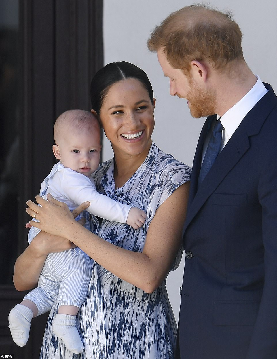 Harry and Meghan, holding Archie, at the Desmond and Leah Tutu Legacy Foundation in Cape Town, September 25, 2019