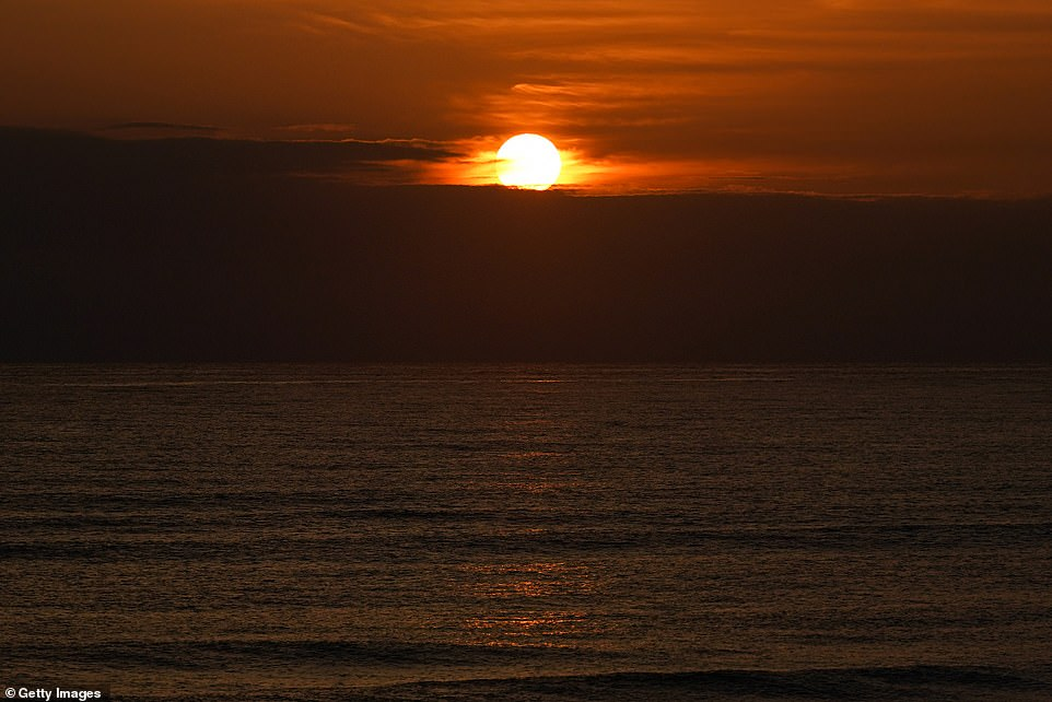 The sun rises over the North Sea on the morning of the summer solstice at Saltburn beach