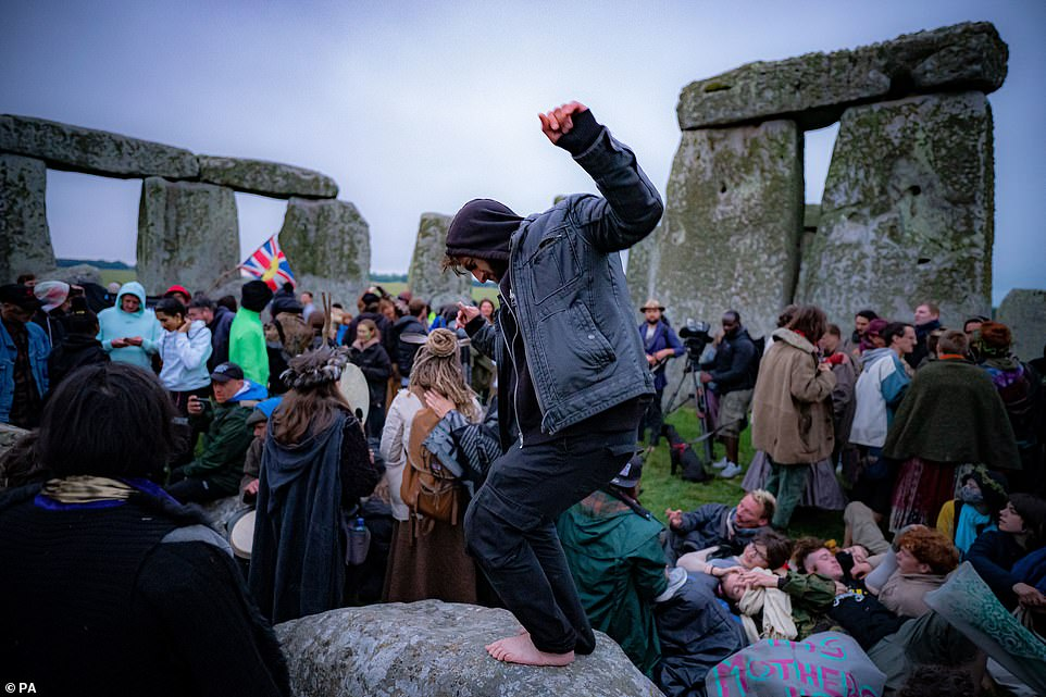 People inside the stone-circle during Summer Solstice at Stonehengein Amesbury