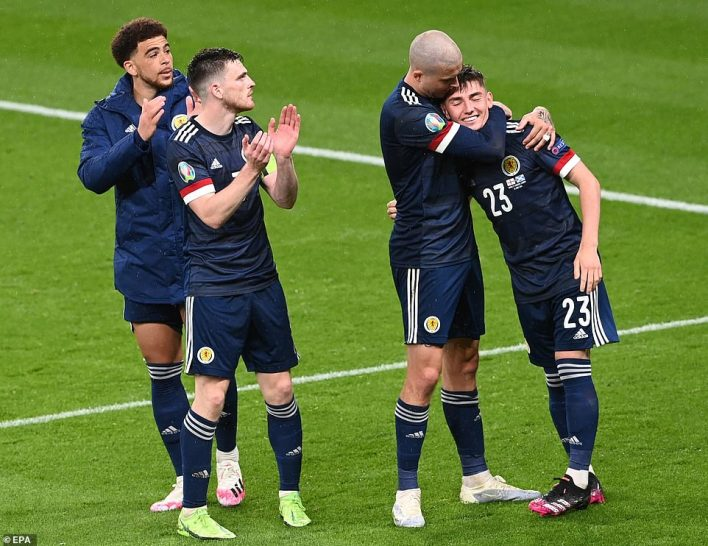 Billy Gilmour (far right) celebrates with Scotland team-mates after he helped his side to a 0-0 draw against England on Friday