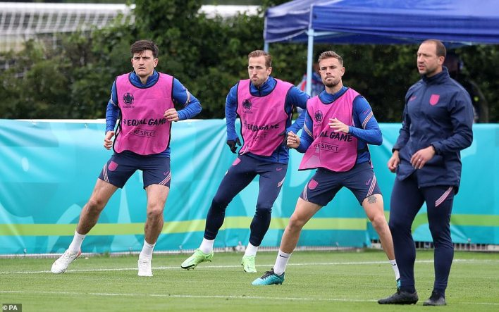 England's Harry Maguire (left), Harry Kane (centre) and Jordan Henderson during a training session this morning