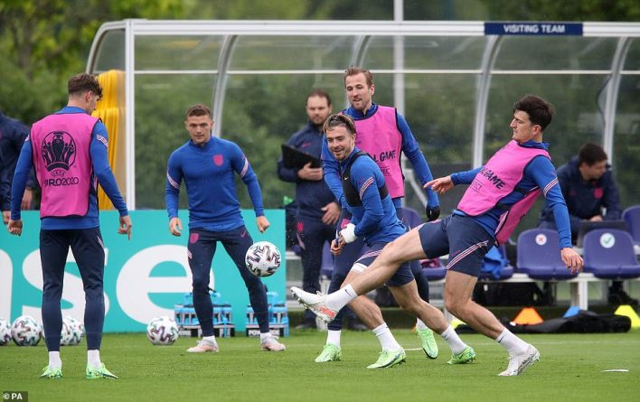 Left to right, England's John Stones, Kieran Trippier, Jack Grealish, Harry Kane and Harry Maguire train in Chigwell today