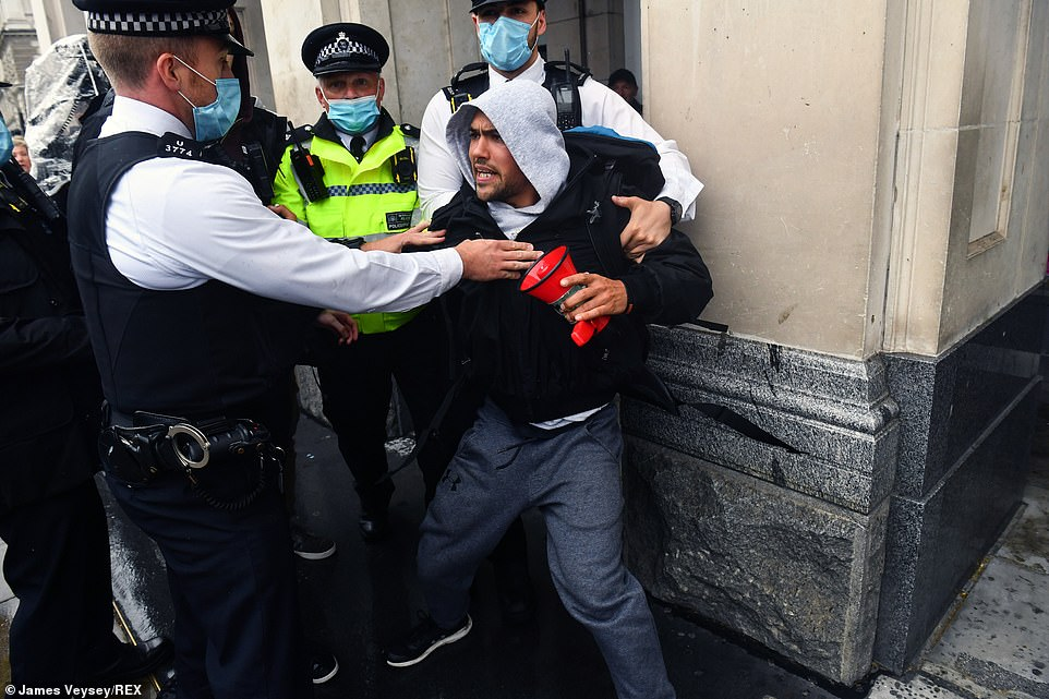 Anti-lockdown protesters clash with police during a demonstration in Parliament Square Anti-lockdown protest, London