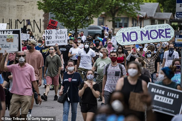 Protesters march through Minneapolis on May 26, 2020, after word of Floyd's murder spread