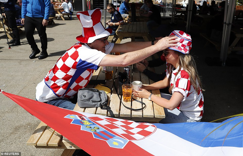 Croatia fans wear their country's colours as they are seen in Glasgow enjoy a drink this afternoon ahead of the match tonight