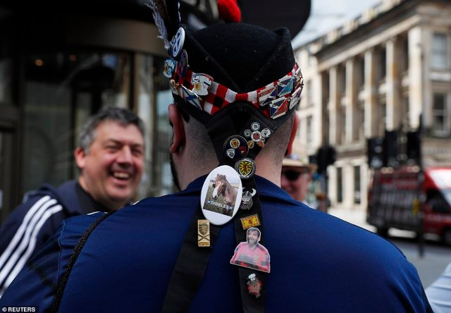 A Scotland fan's badges are pictured in Glasgow today ahead of the Euro 2020 match against Croatia this evening