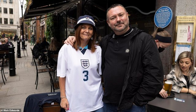 Three Lions supporters have started knocking back pints as they ready themselves for England's final group stage game of Euro 2020. Pictured: England fans at a pub in London ahead of the match tonight