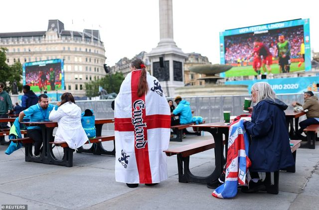 Three Lions fans draped in England flags are gathering at Trafalgar Square tonight, where the game will be shown on big screens
