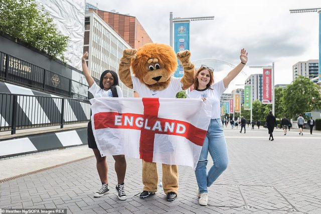 An England fan dresses in a Lion costume - the mascot of England's national team - ahead of the game against Czech Republic at Wembley