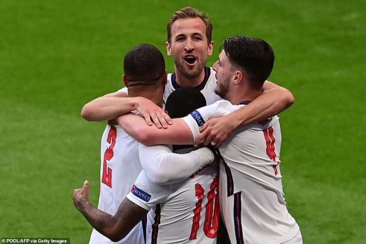 England's No 10 is swarmed by his team-mates, who congratulate him for scoring the opening goal on Tuesday evening
