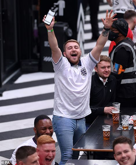An England fans cheers on the Three Lions at Box Park in Croydon