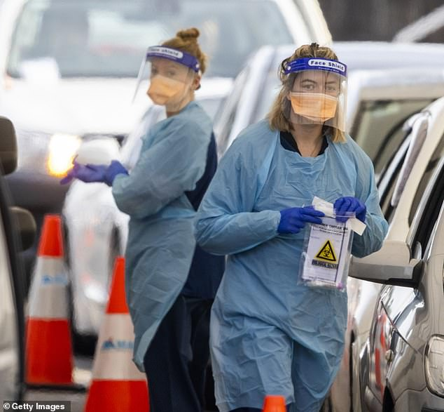 Health workers are pictured at the Bondi Beach Drive-through Covid-19 clinic in Sydney's eastern suburbs on Wednesday