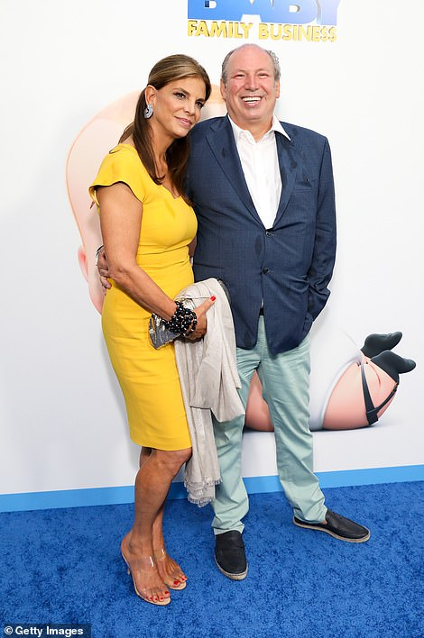 Date night:Hans Zimmer, who composed the film's score, attended the premiere with his wife Suzanne, who stunned a marigold wiggle dress