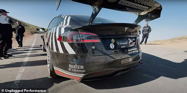 The Model S Plaid's exterior is fitted with an adjustable rear wing, complete with a Dogecoin sticker. The Model S Plaid took off in a flash from the starting line and embarked on its journey to the top of the mountain