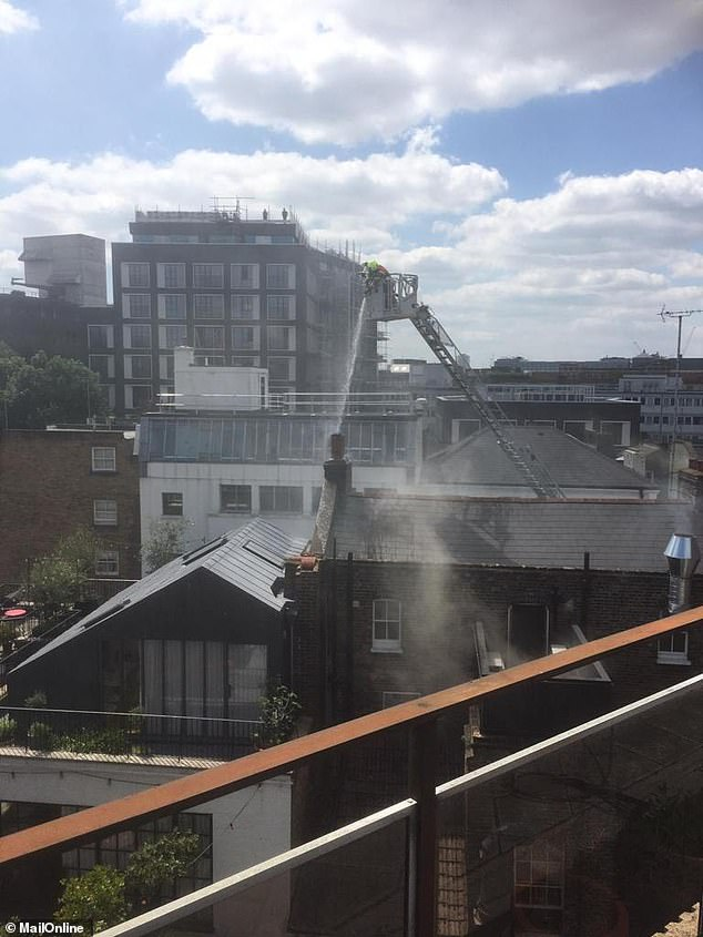 Firefighters poured water on the roof in an attempt to put out the blaze, whichis said to have started in an extraction system from the first floor to the roof vent
