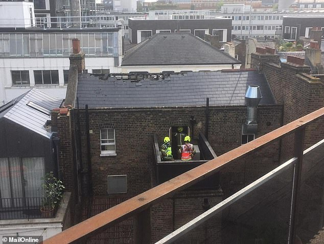 Guy Ritchie's Camden Pub was left holes in the roof after a fire broke out on Wednesday and 70 firefighters battled the blaze, with a witness saying the 'smoke was so intense'