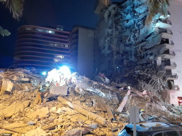 A rescue operation is underway after an apartment building near 88th street and Collins Avenue in Miami Beach collapsed (pictured) in the early hours of this morningWitnesses claimed to have heard people screaming beneath the rubble