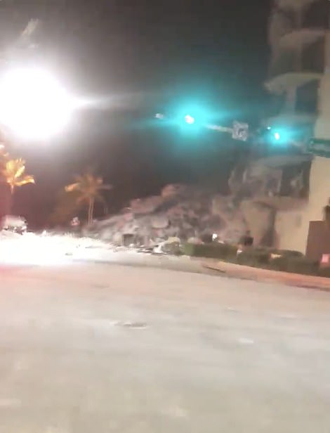 Shocking pictures and videos (above) show what appears to be huge piles of debris lying at the corner of Collins Avenue as fears