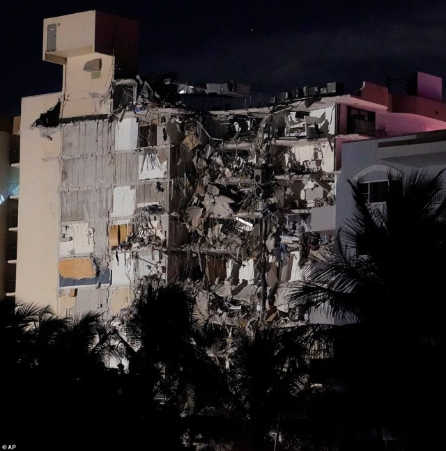 Pictures and videos from the scene suggest a full section of the tower collapsed (pictured), which left huge piles of debris lying at the corner of Collins Avenue