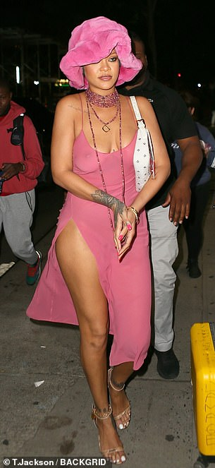 All eyes on her: Rihanna showed off her cleavage as she went braless in the figure-hugging number