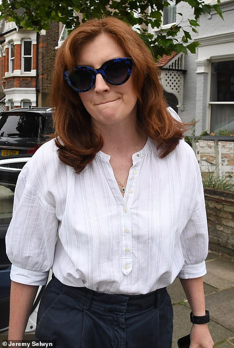 Martha Hancock leaves the couple's north London home yesterday morning after claims that her husband has been having a secret affair. She didn't comment