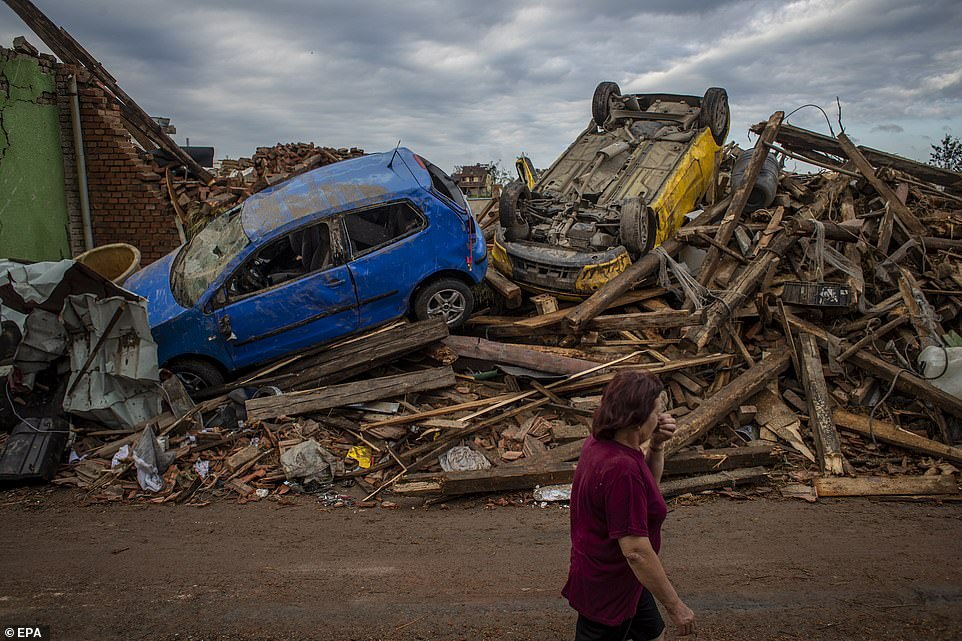 Devastation: Cars were tossed around and buildings completely flattened by the force of the 200mph tornado yesterday