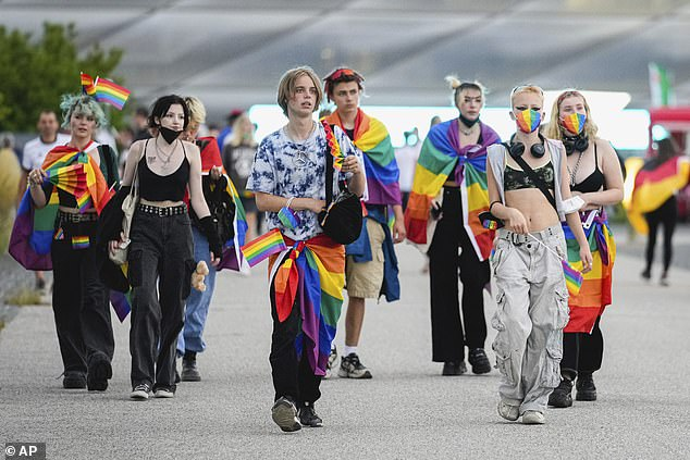 People wear rainbow flags before the Euro 2020 soccer championship group F match between Germany and Hungary at the Allianz Arena in Munich, Germany