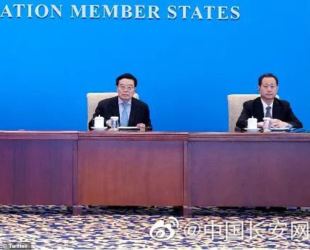 Dong Jingwei is purportedly shown in the image on the right at the meeting in Shanghai