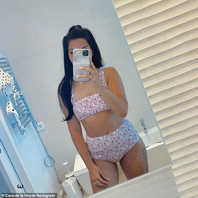 'Not bad for two kids': Cara De La Hoyde, 30,proudly showcased her post-baby figure in a floral bikini for a mirror selfie on Instagram on Friday