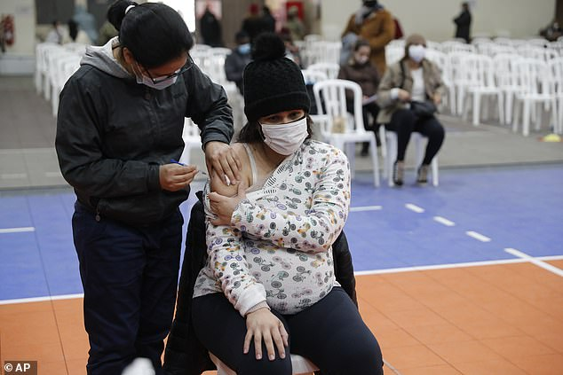 A new NIH study will enroll 750 pregnant women and 250 mothers who have given birth within the last two months to measure the development and longevity of antibodies generated by COVID-19 vaccines. Pictured: Nurse Rita Rojas inoculates a pregnant woman with a dose of the Moderna COVID-19 vaccine, June 2021