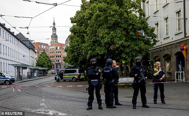 Police securing the cordoned-off area in the city centre today.Several victims were treated by emergency services. No information on their condition was released