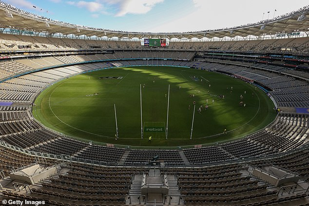 The AFL match between West Coast Eagles and Western Bulldogs went ahead without any spectators (pictured, the empty Optus Stadium on Sunday)