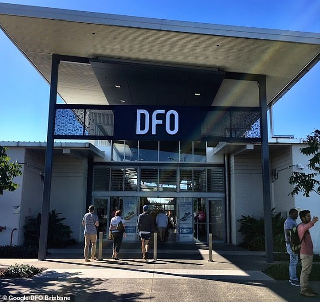 A retail worker at the DFO shopping centre near Brisbane Airport tested positive for the virus before her partner also developed symptoms - with 26 related exposure sites now listed