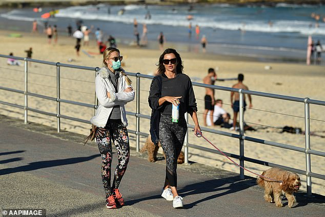Many were seen walking out in Sydney (pictured at Bondi Beach on Sunday) as the city endured the start of its two week lockdown