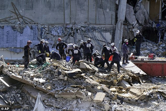 Workers sift among the rubble of the site on Sunday, with workers trying to rescue any potential survivors without putting them at risk of further injury from rubble