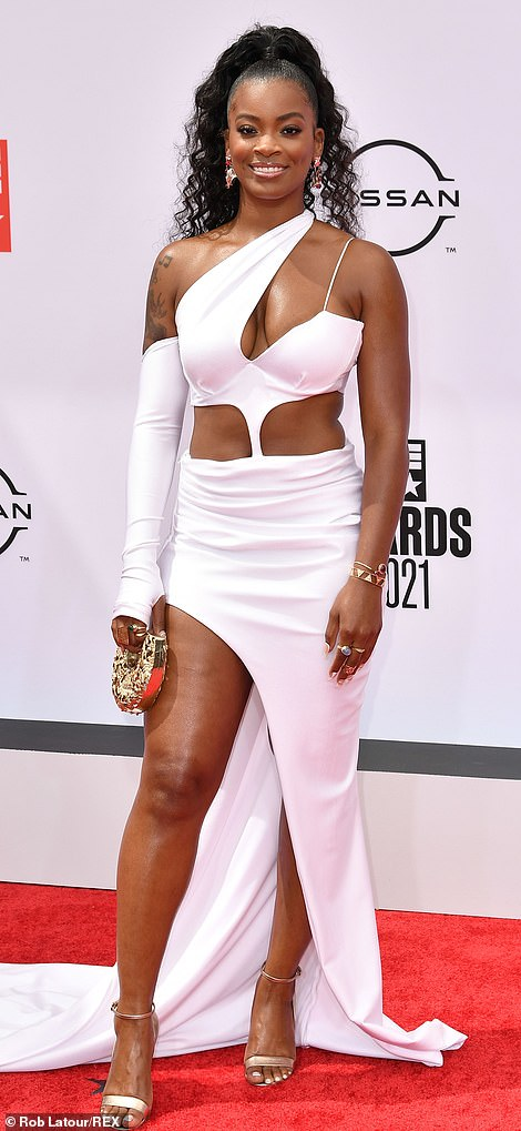 Looking divine! Ari Lennox looked fabulous in a pristine white number while Eva Marcille worked a revealing number