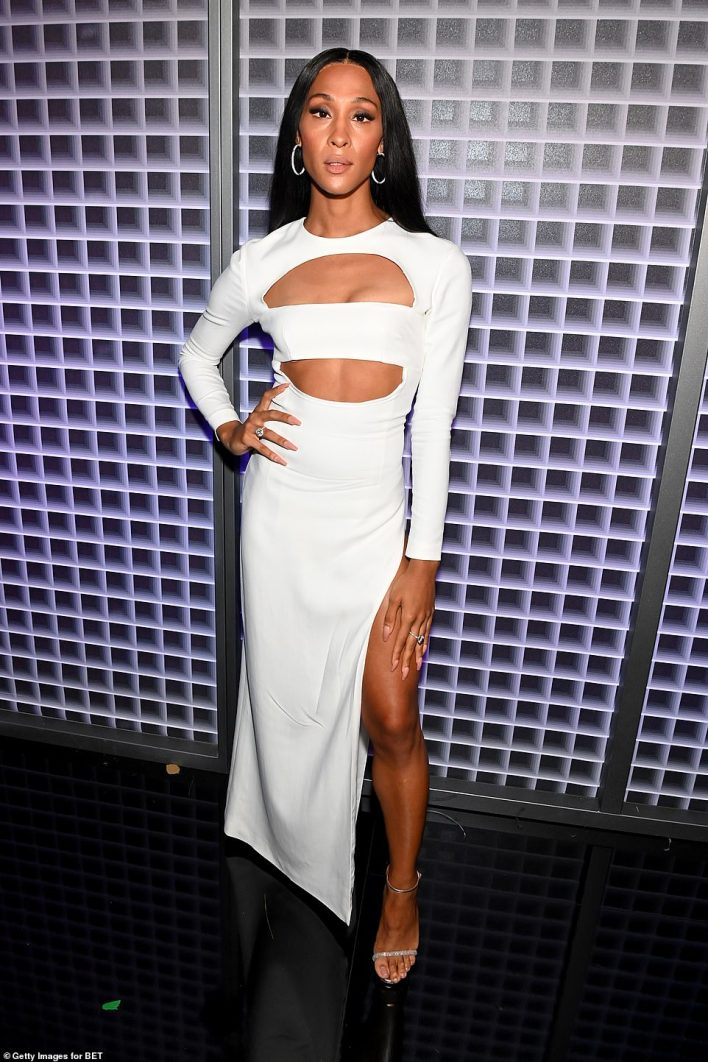 Stunning! MJ Rodriguez flashed some leg in a chic yet sexy white dress with several cut-outs and a thigh-high slit